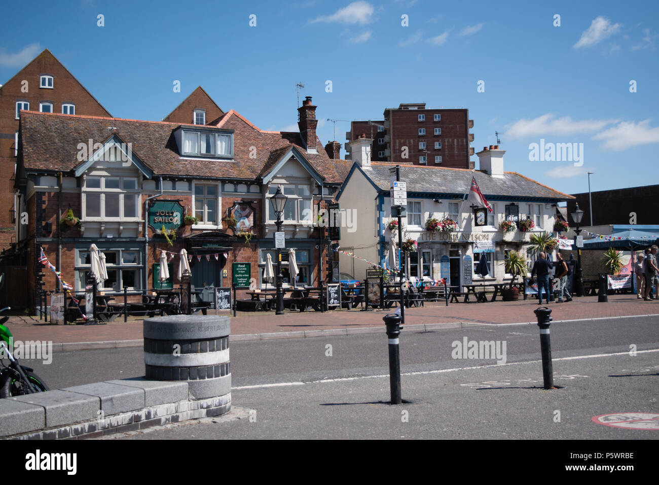 On the Quayside at Poole Harbour showing the Jolly Sailor and The Lord Nelson public houses on a hot Summers morning before opening time. - Stock Image