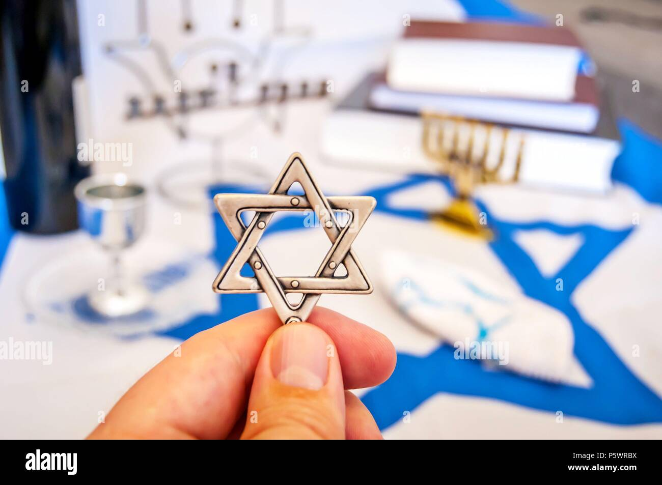 Hand Holding A David Star Magen David In Hebrew A Traditional