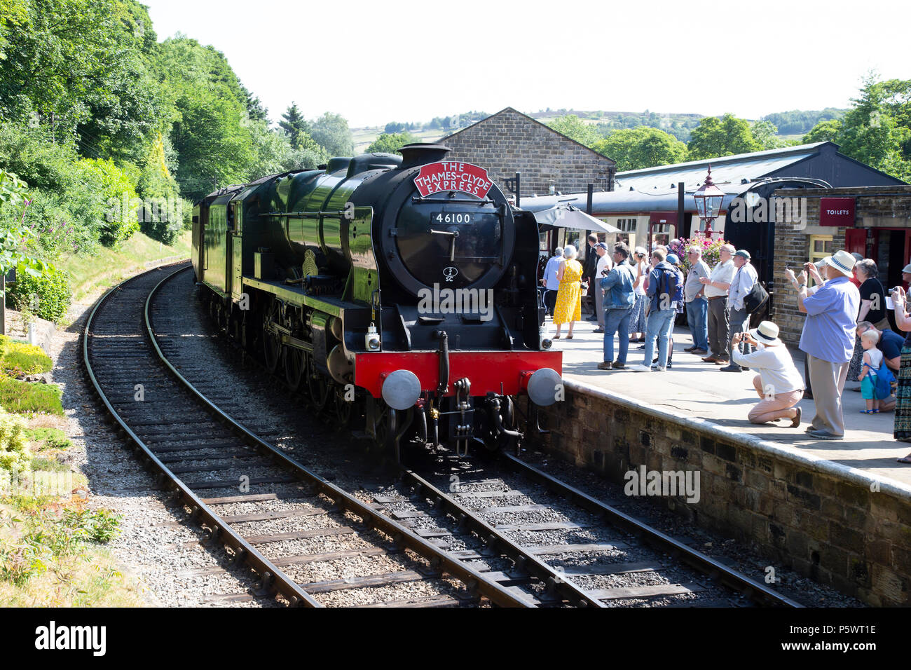 LMS steam locomotive Royal Scot class 6100 pulling into Oxenhope station on the Keighley and Worth Valley Railway during their 50th Anniversary - Stock Image