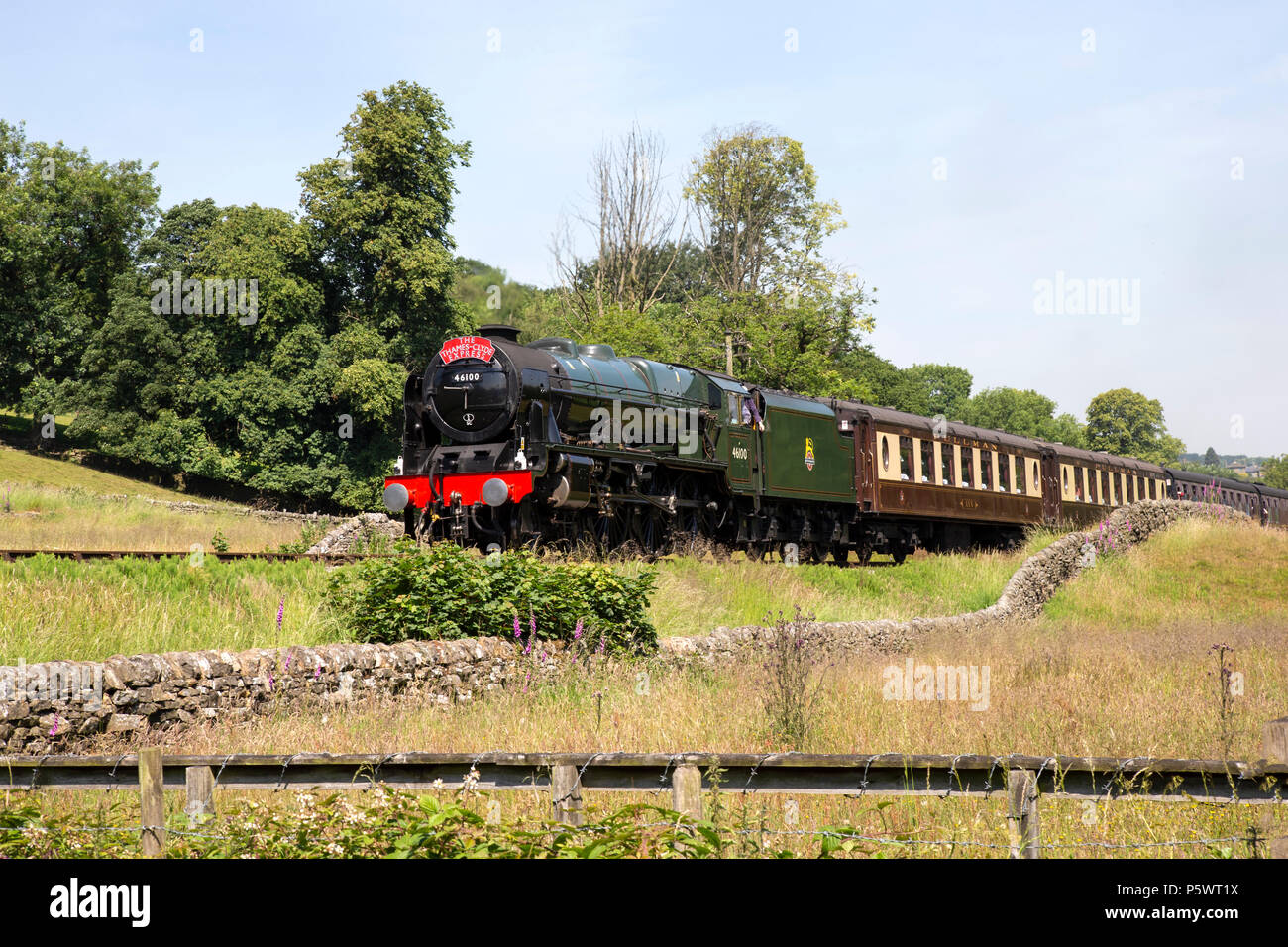 LMS steam locomotive Royal Scot class 6100 hauling a pullman train on the Keighley and Worth Valley heritage line during the 50th Anniversary gala - Stock Image