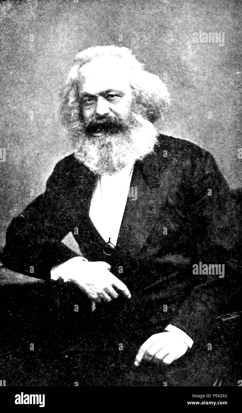 Black and white portrait photograph of German economist and philosopher Karl Marx (circa 1875) seated, in three-quarter view, with a bushy white beard, dark mustache, and receding hairline, wearing a dark suit, with a serious expression on his face, from the volume 'Men and Thought in Modern History, ' authored by Ernest Scott and published by Macmillan, California, 1920. Courtesy Internet Archive. () - Stock Image
