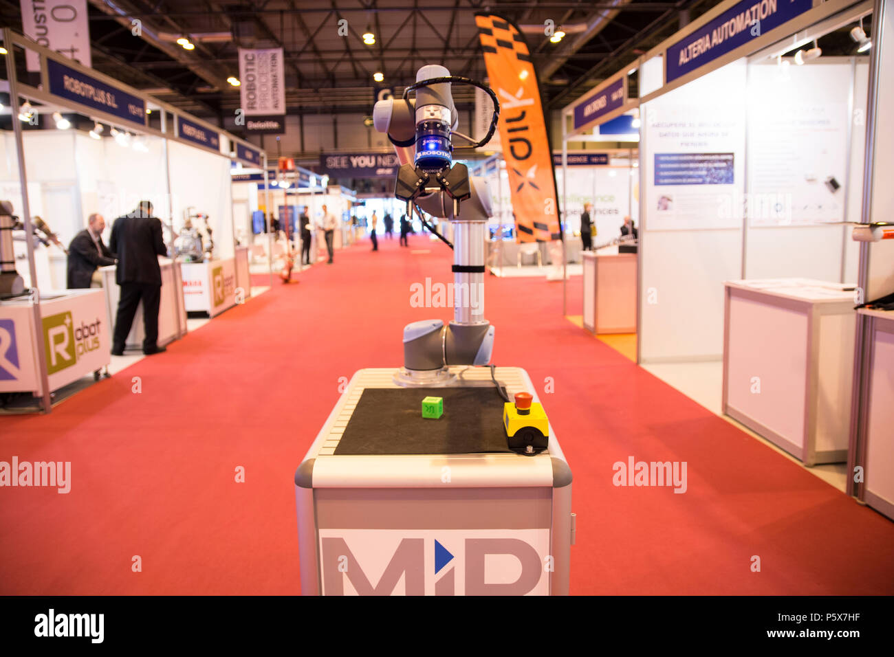 A mini robot factory 4.0 from Robotplus company rolls by GR-EX (Global Robot Expo) summit. - Stock Image