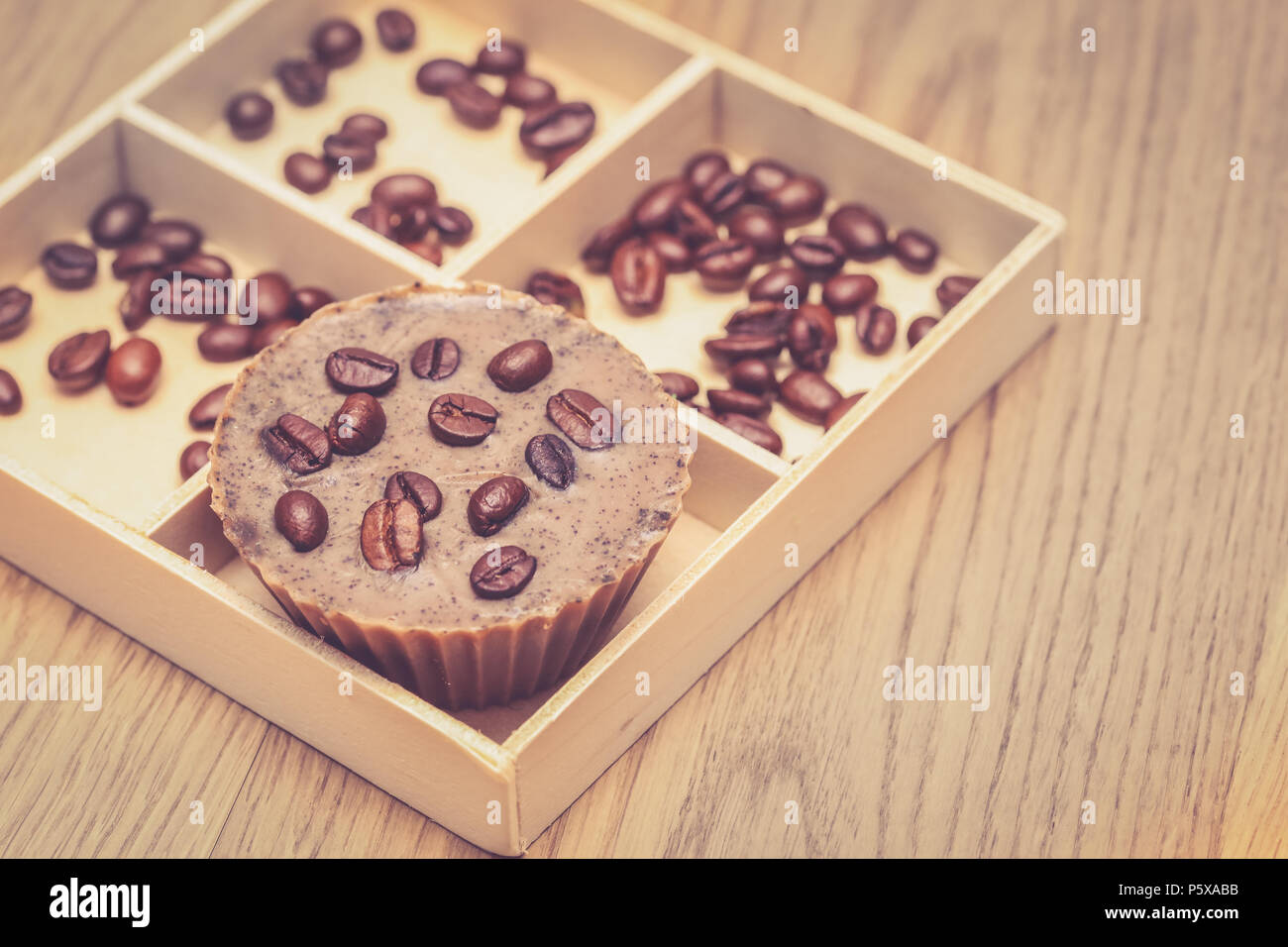 Homemade coffee soap with coffee beans in a wooden box - Stock Image
