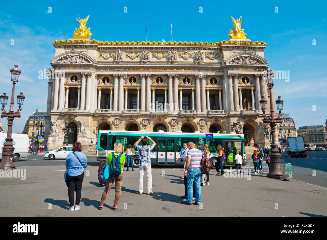 Tourist in front of the Opera House, Palais Garnier, Place de l'Opera, Paris, France - Stock Image