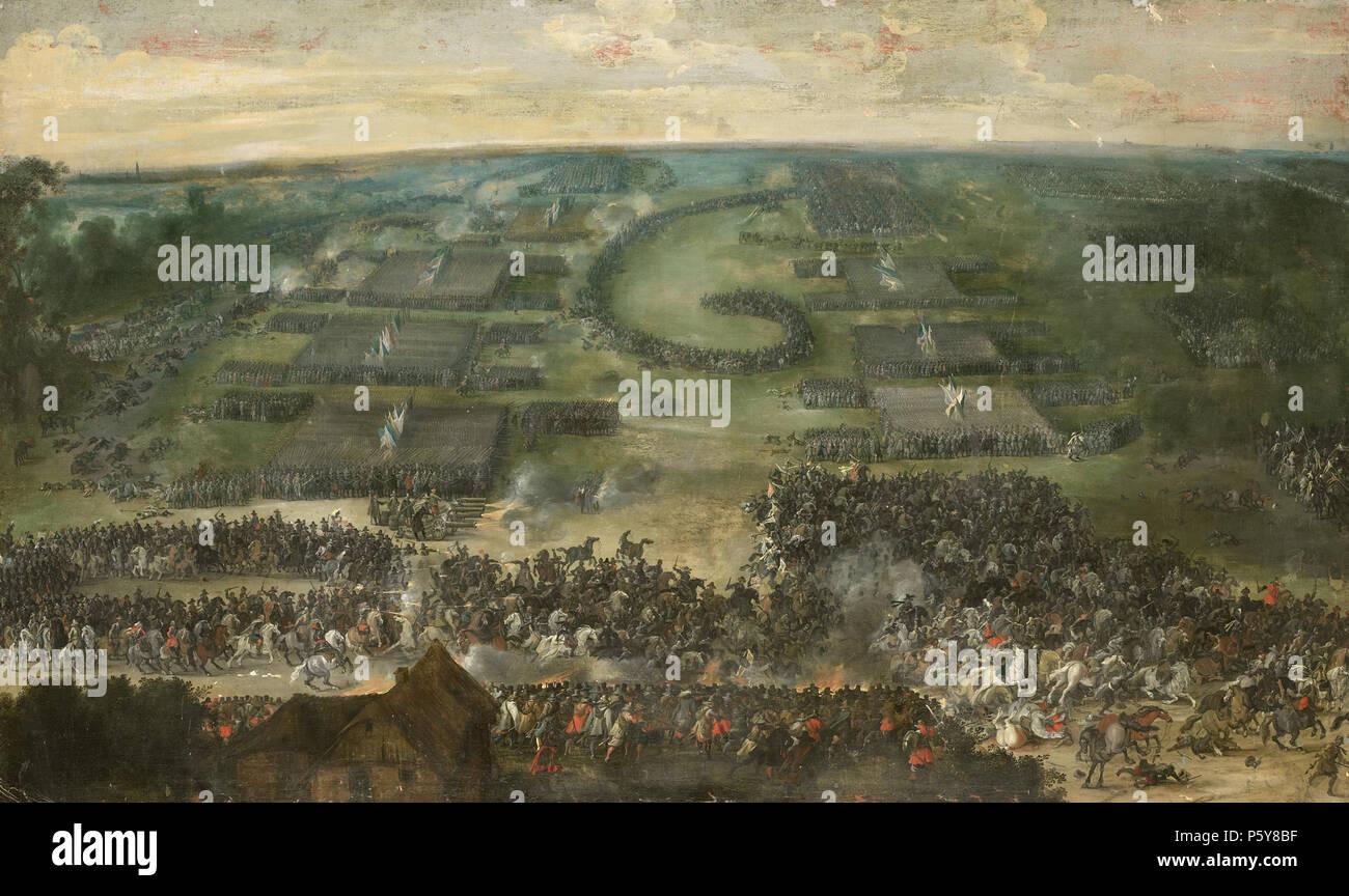 Een veldslag .  Nederlands: Een grote veldslag gezien in vogelvluchtperspectief. Op de voorgrond een cavaleriegevecht, daarachter artillerie en infanterie. Boven maakt een divisie ruiters een spiraalvormige beweging. Wellicht de slag bij Wimpfen in Duitsland in 1622. . between 1615 and 1650. N/A 496 Een veldslag Rijksmuseum SK-A-1555 - Stock Image