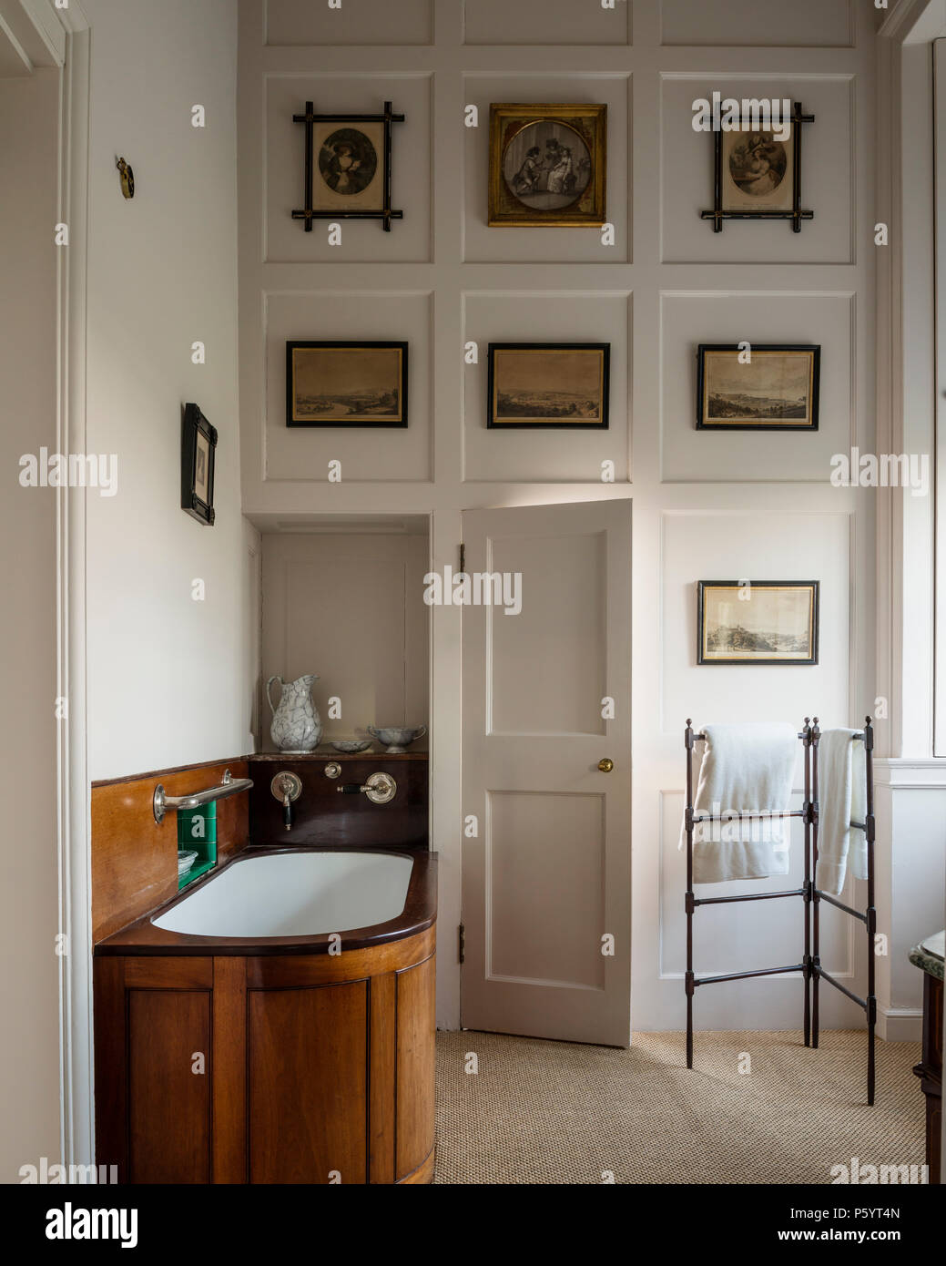 Old-fashioned bath with wood panels in bathroom Stock Photo