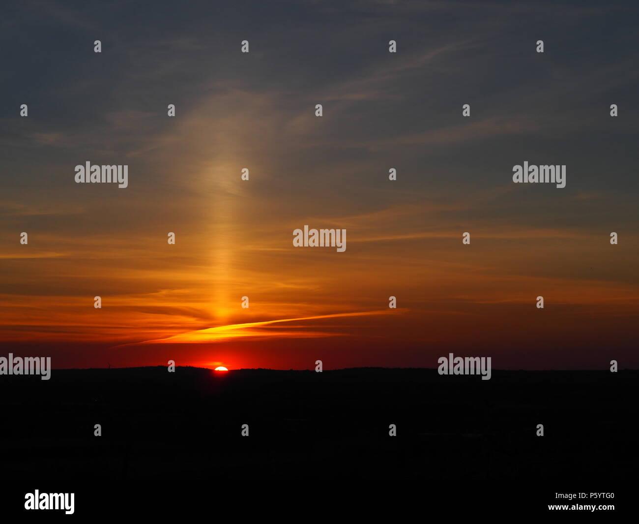 Rare Sun Pillar cirrus cloud  phenomenon above a vivid sunset over Aylesbury Vale, Buckinghamshire seen around midsummer. - Stock Image