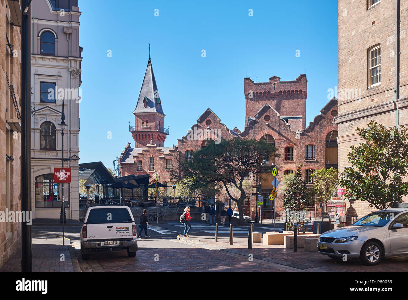 The Australasian Steam Navigation Building from Atherden Street in The Rocks with surrounding buildings on a sunny cloudless day, Sydney, Australia Stock Photo