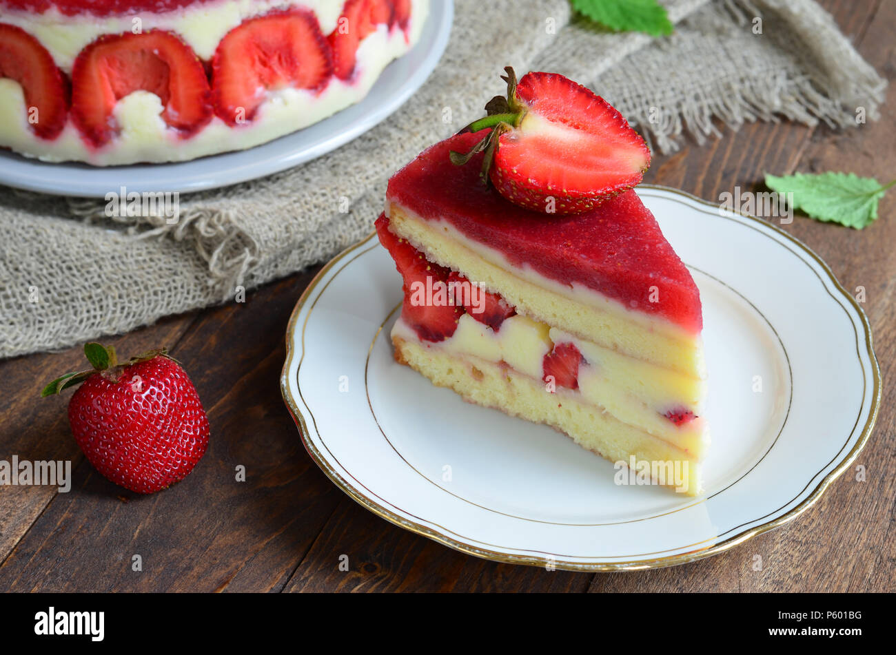 Strawberry cake, Fraisier cake on wooden background - Stock Image