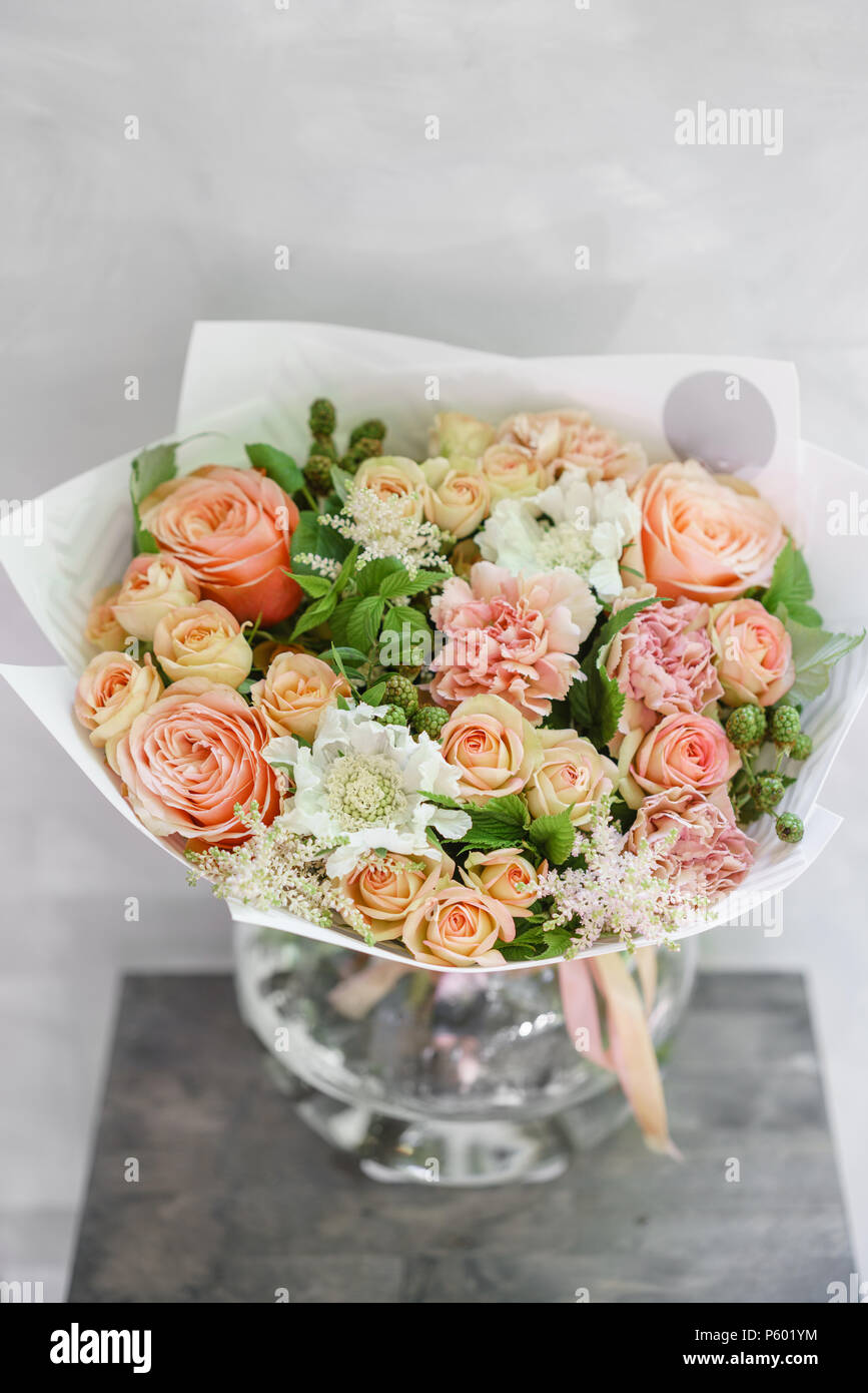 Work florist beautiful spring bouquet arrangement with mix flowers beautiful spring bouquet arrangement with mix flowers the concept of a flower shop a small family business color light peach and orange mightylinksfo