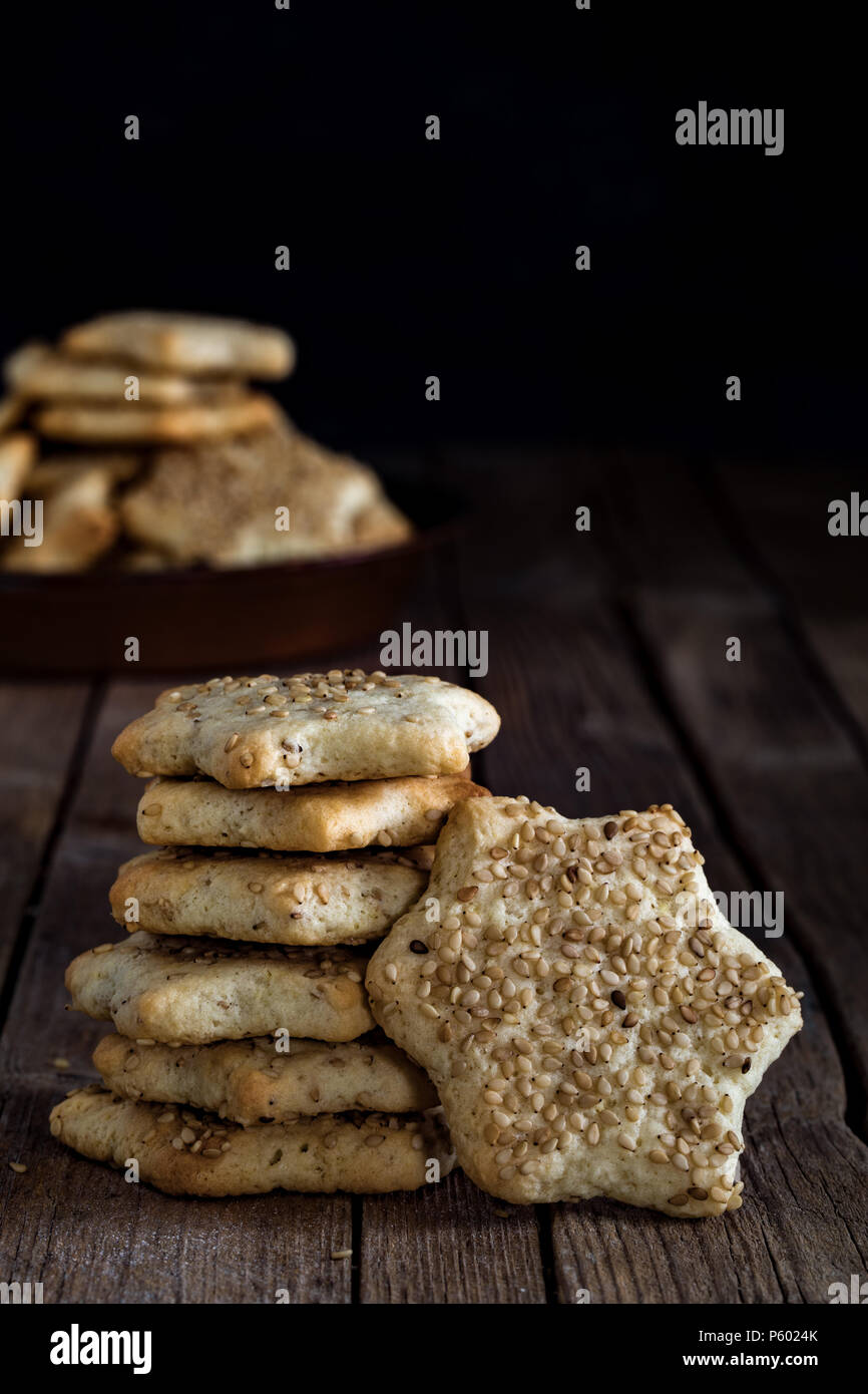 Star shaped biscuits with sesame seeds, made with Sicilian recipe, for winter holidays. - Stock Image