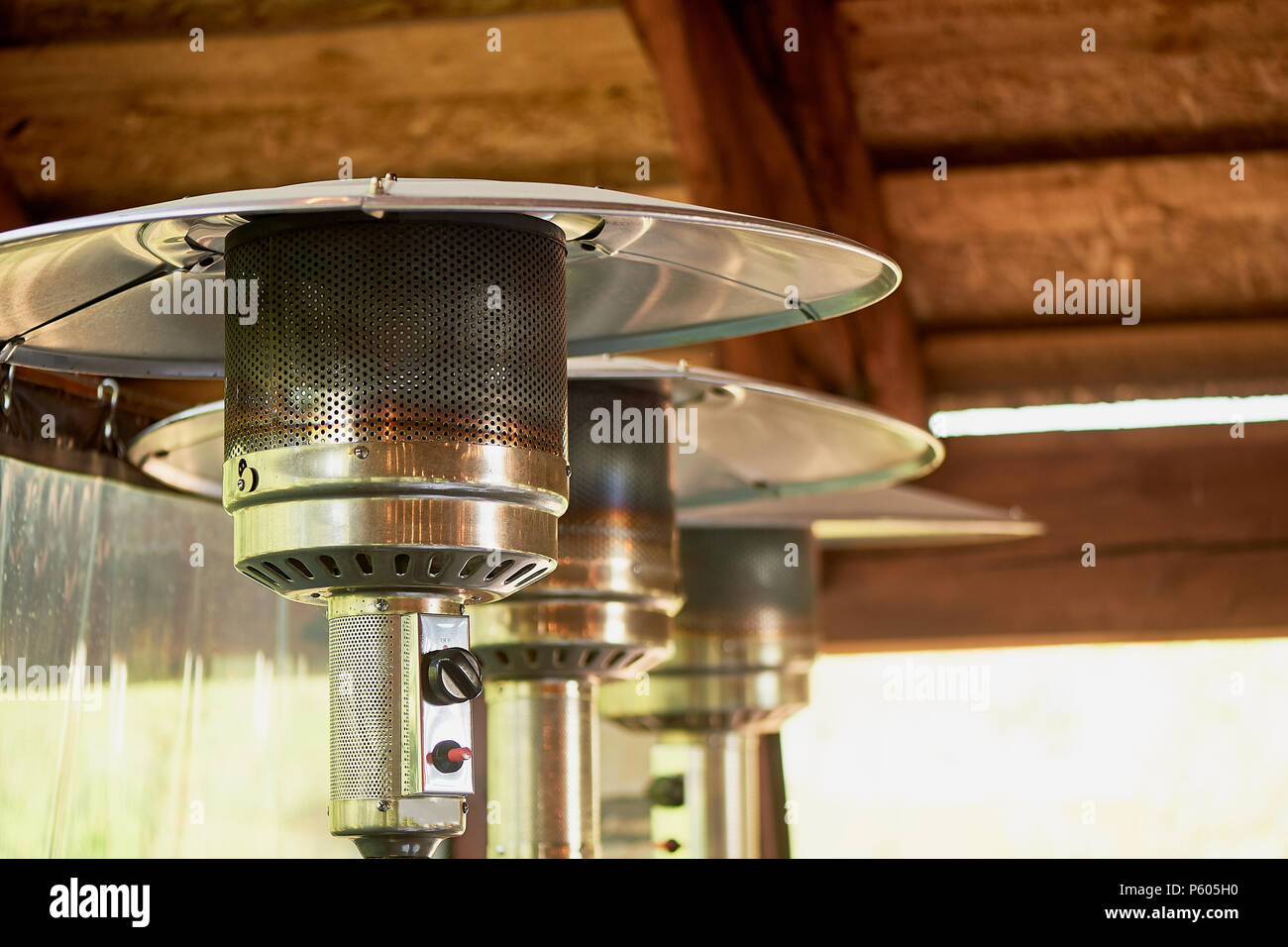 Heat lamp for heating the terrace of a cafe or restaurant.For the Banquet. - Stock Image