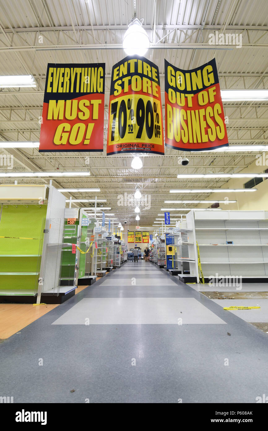 Going Out Of Business Signs Hang Inside A Nearly Empty Toys R Us