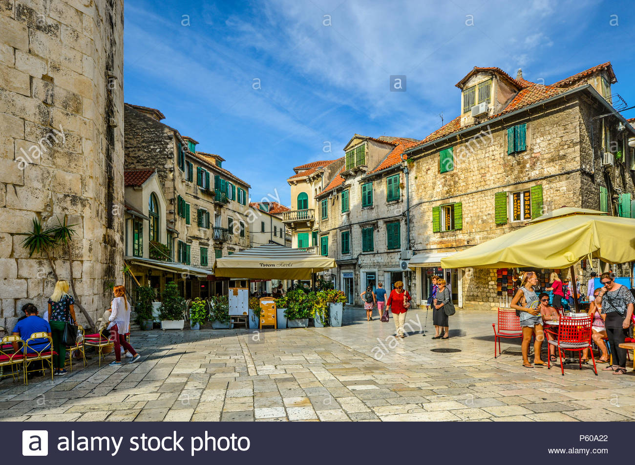 Tourists enjoy cafes and shops on an early autumn afternoon on the Fruit Square in the Diocletian's Palace section of Old Town Split, Croatia. Stock Photo