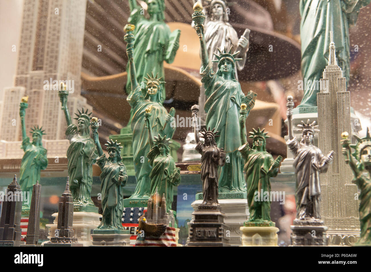 Cheap models of The Statue of Liberty on sale for tourists in a shop window in Manhattan, New York City - Stock Image