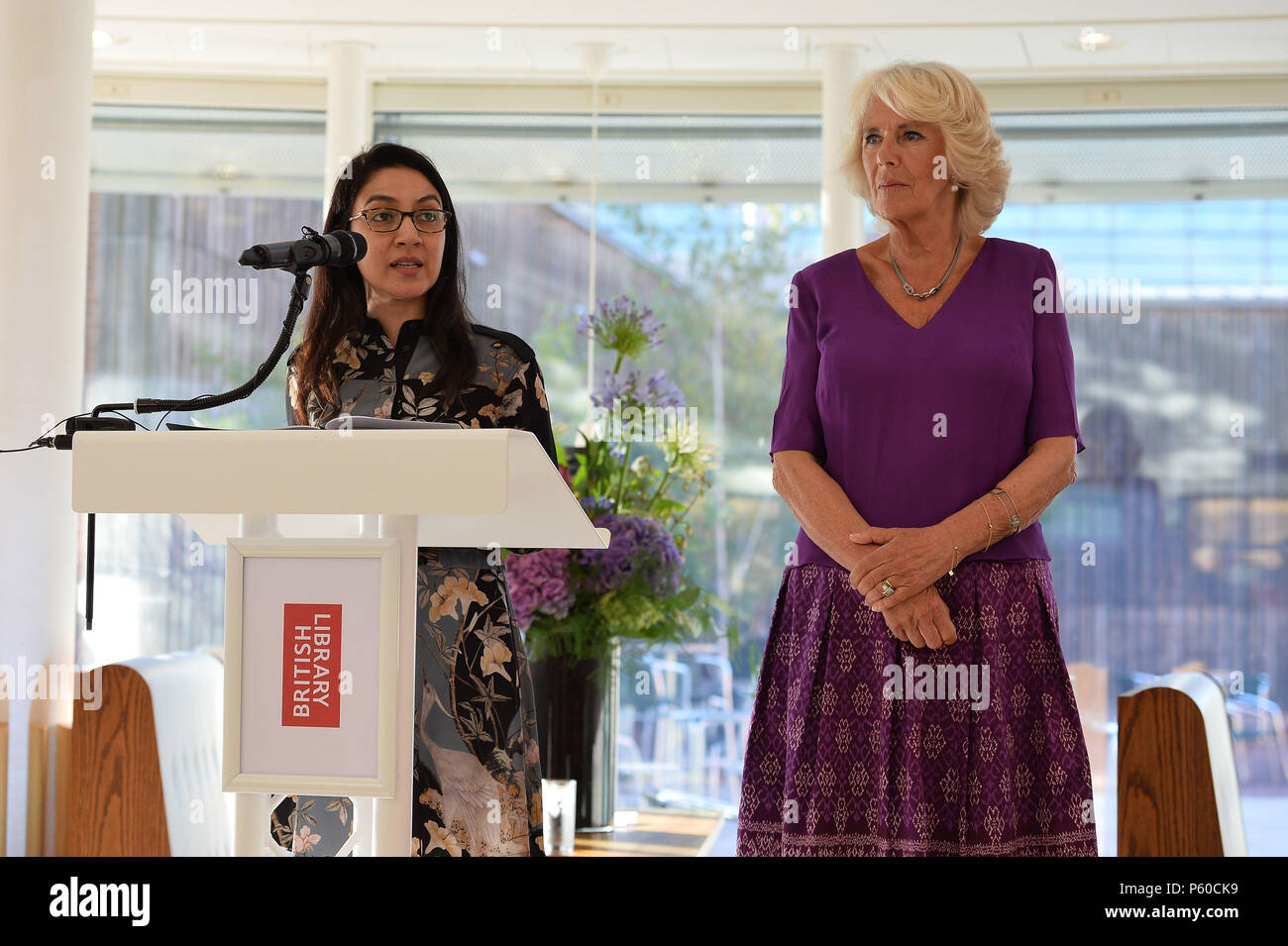 RSL Fellow Tahmima Anam (left) speaking as the Duchess of Cornwall attends a reception at the British Library in London hosted by the Royal Society of Literature where '40 under 40' new Fellows will be inducted. - Stock Image
