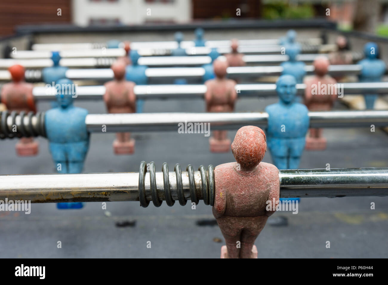 vintage table football box with red blue player close up washed out - Stock Image