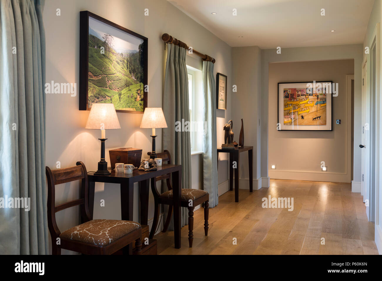 Lit lamps in hallway - Stock Image