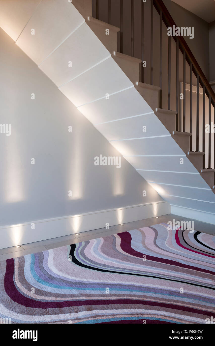 Modern rug under staircase - Stock Image