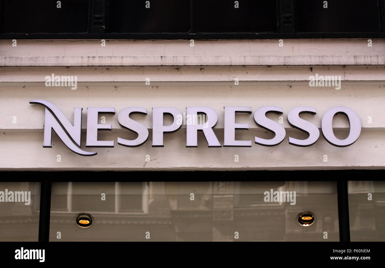 Copenhagen, Denmark - June 26, 2018: Nespresso coffee house store logo on shop panel. Nespresso Nestle group brand has a presence in over 60 countries - Stock Image