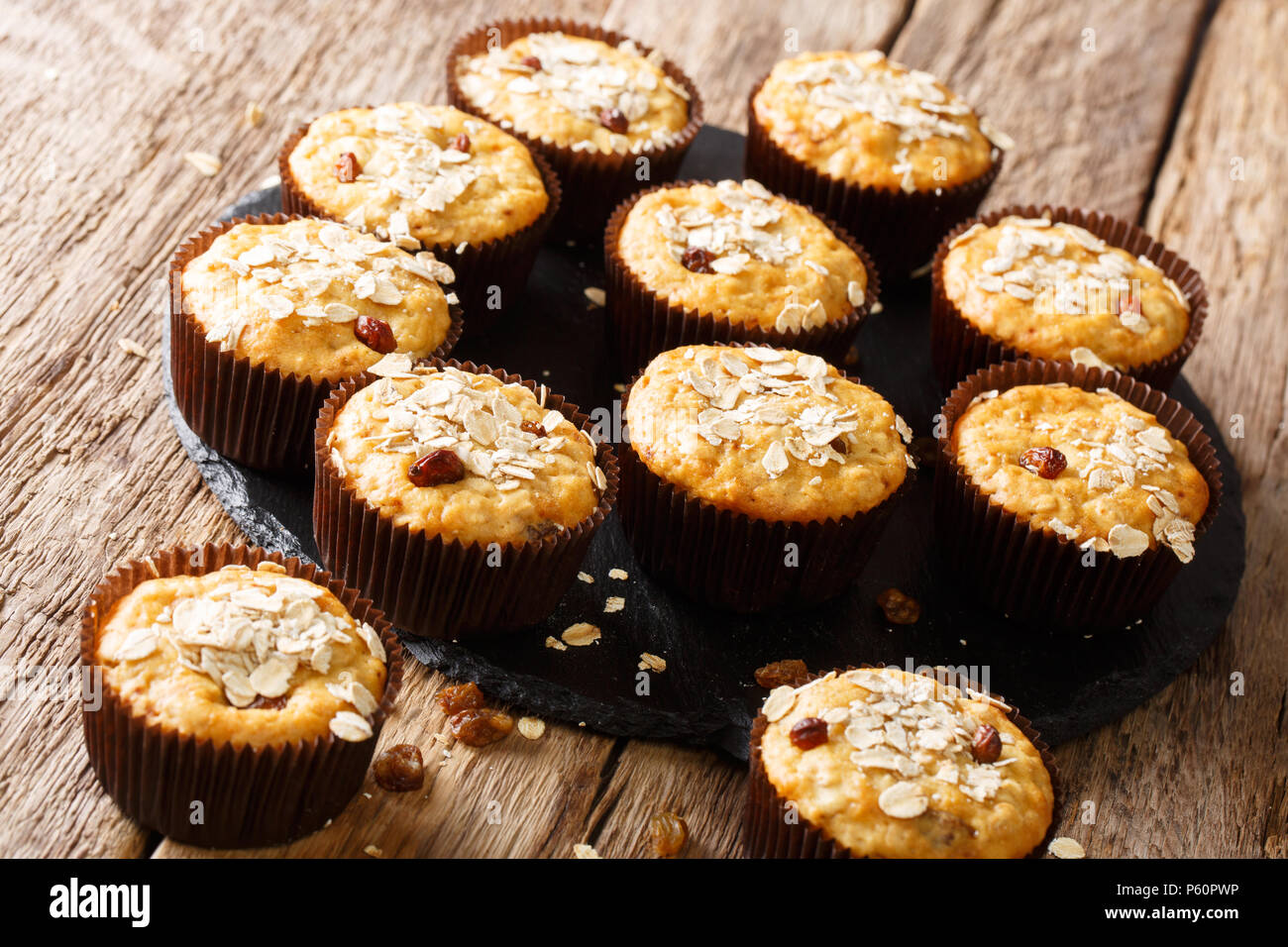 Low-calorie muffins of oatmeal with raisins and honey close-up on the table. horizontal - Stock Image