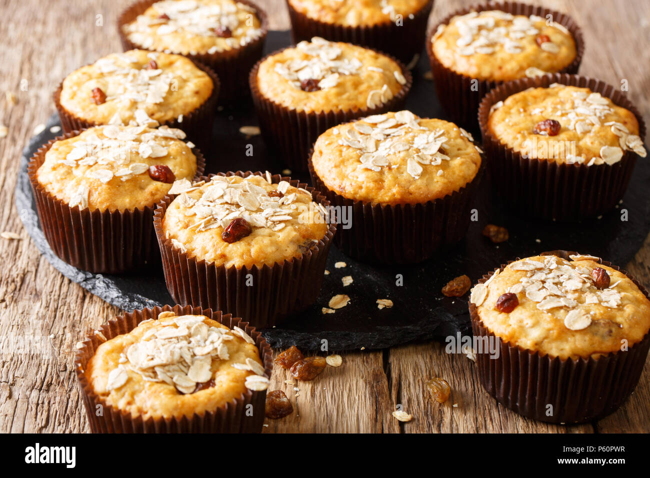 Dietary muffins from oat flakes with raisins and honey close-up on the table. horizontal - Stock Image