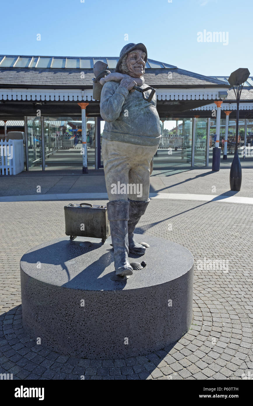 The famous 'Jolly Fisherman' statue at the railway station in the seaside town of Skegness, Lincolnshire,UK - Stock Image