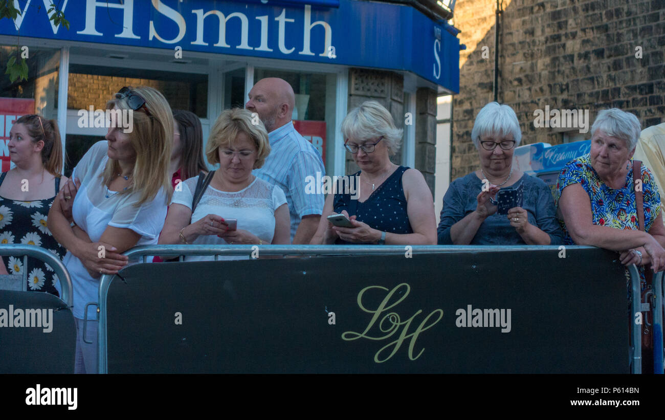 Ilkley, West Yorkshire, UK. 27th June 2018.  Keen fans take to their phones to send photos of Alistair Brownlee as he takes part in the Ilkley Cycle Races. Rebecca Cole/Alamy Live News Credit: Rebecca Cole/Alamy Live News - Stock Image