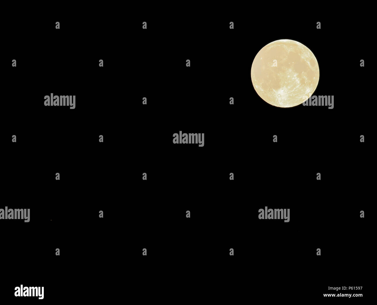 Lurgan, Northern Ireland, UK. 28 June 2018. - the June full moon and Saturn in the night sky. Shot taken at  01.09 BST. Saturn at approximately 7 o'clock position. Credit: David Hunter/Alamy Live News. - Stock Image