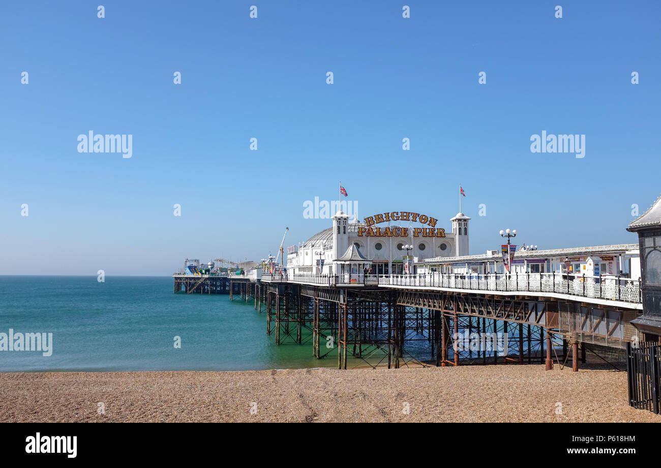 Brighton UK 28th June 2018 - Brighton Palace Pier showing off its new neon sign today after changing its name from Brighton Pier . The pier was built in the 1890s and named Brighton Marine Palace  and Pier but became known locally  as the Palace Pier until 2000 when it was rebranded Brighton Pier. Luke Johnson executive chairman of the Brighton Pier Group has now announced that it will be known as Brighton Palace Pier Credit: Simon Dack/Alamy Live News - Stock Image