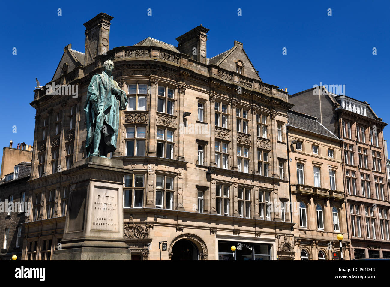 Bronze sculpture of William Pitt the Younger a British Prime Minister on George and Frederick streets Edinburgh Scotland with historic buildings - Stock Image
