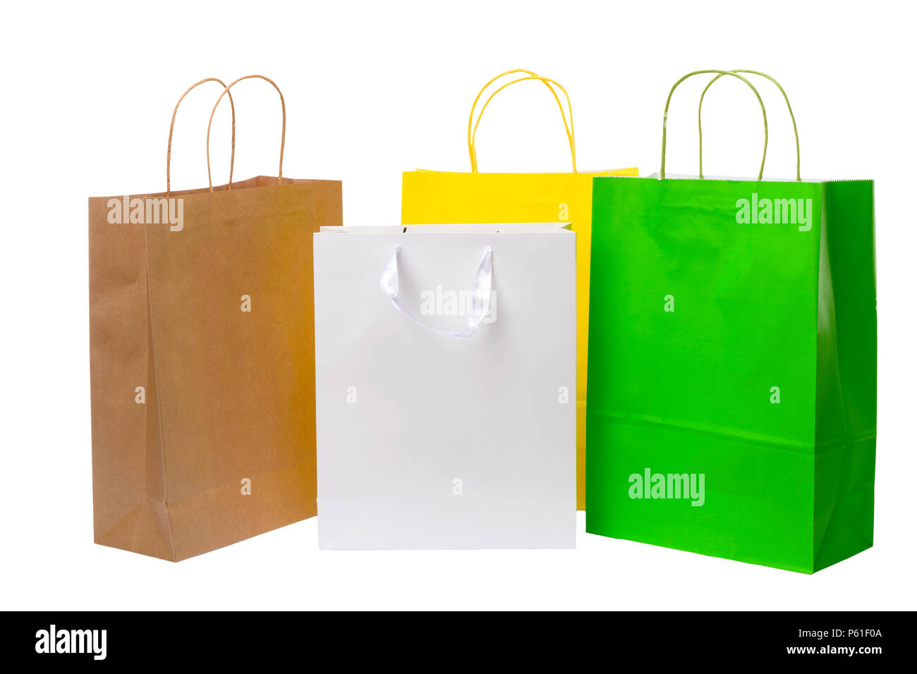 Variety of colored paper shopping bags on white background. Empty area. - Stock Image