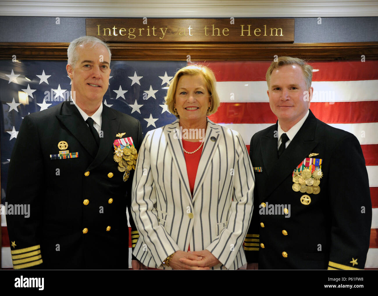 160408-N-OG138-092 NEWPORT NEWS, Va., (April 8, 2016) Capt. John F. Meier, commanding officer of Pre-Commissioning Unit Gerald R. Ford (CVN 78), and Capt. Richard McCormack pose with Susan Ford Bales, ship sponsor and guest speaker.  Ford is the first of a new class of aircraft carriers currently under construction by Huntington Ingalls Newport News Shipbuilding. (U.S. Navy photo by Mass Communication Specialist 3rd Class Matthew R. Fairchild/Released) - Stock Image