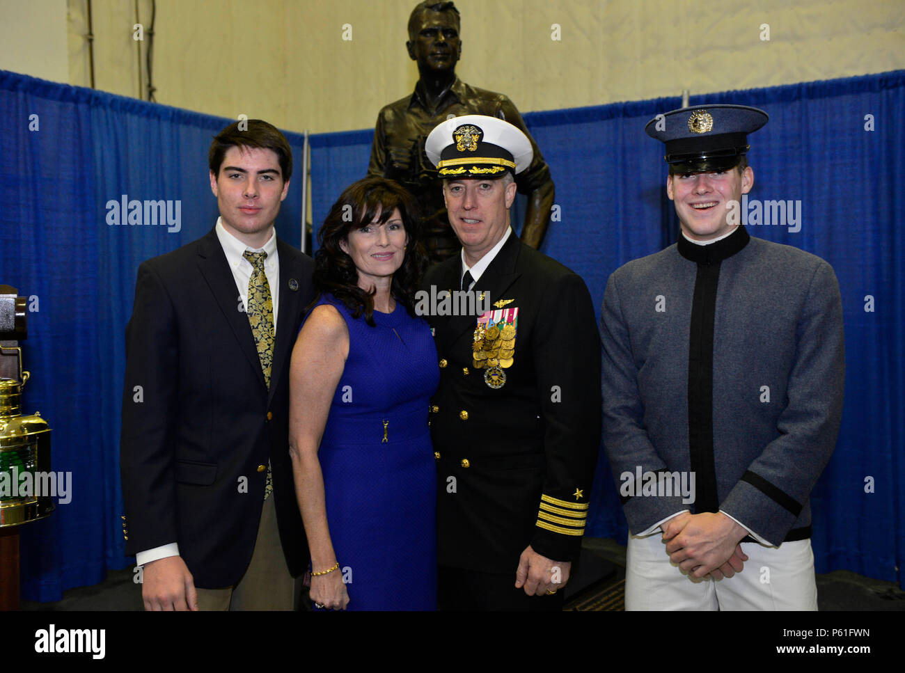 NEWPORT NEWS, Va., (April 8, 2016) -- Capt. John F. Meier poses with his family following a change of command in Pre-Commissioning Unit Gerald R. Ford's (CVN 78) hangar bay.  Ford is the first of a new class of aircraft carriers currently under construction by Huntington Ingalls Newport News Shipbuilding. (U.S. Navy photo by Mass Communication Specialist Seaman Apprentice Gitte Schirrmacher/Released) - Stock Image