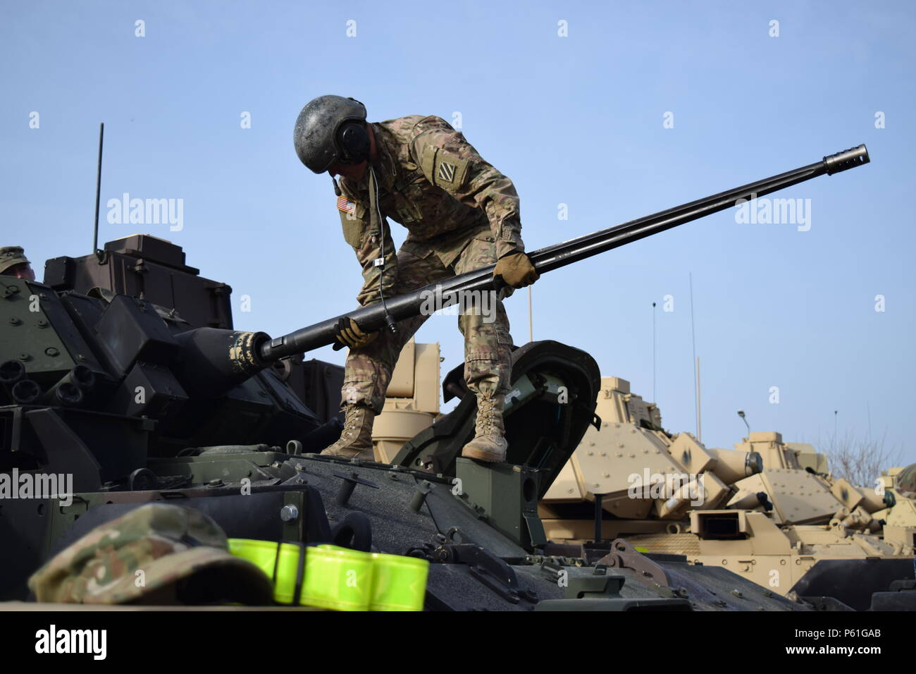 Soldiers from 1st Battalion, 64th Armor Regiment perform Preventive Maintenance Checks and Services on an M2A3 Bradley Infantry Fighting Vehicle as they draw equipment from the European Activity Set at Mihail Kogălniceanu Air Base, Romania April 7. PMCS is a precursor of signing for the equipment, which the battalion will use to shoot gunnery in Romania to prepare the battalion to join over 25,000 participants from 24 countries for Exercise Anakonda 16 in Poland. Anakonda 16 is a Polish national exercise that seeks to train, exercise and integrate Polish national command and force structures Stock Photo