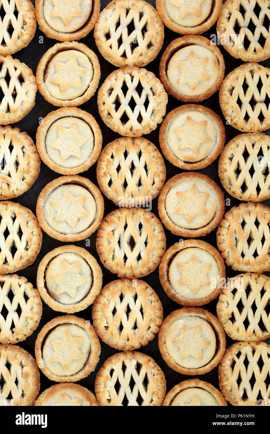 Home made Christmas mince pies forming and abstract background. Flat lay. - Stock Image