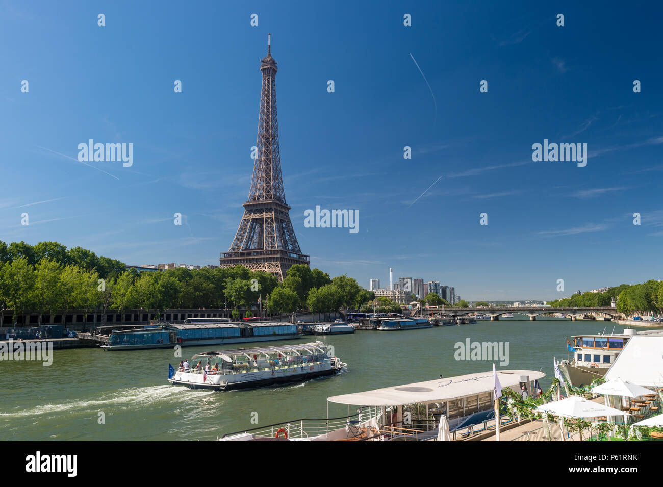 Paris, France - 23 June 2018: Bateau Mouche on the Seine river with Eiffel Tower in the background - Stock Image