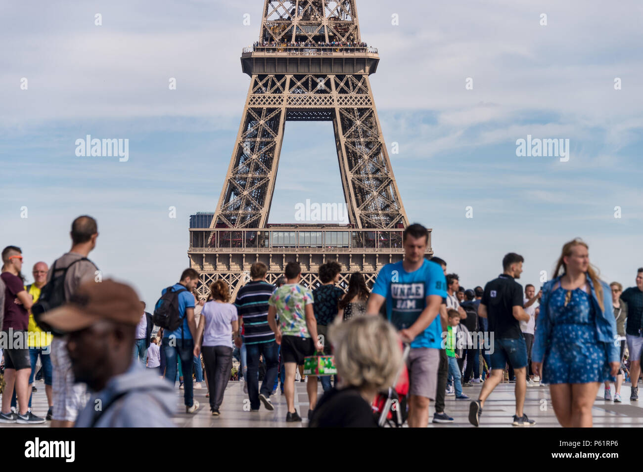 Paris, France - 23 June 2018: Eiffel Tower from Trocadero with many tourists in the foreground - Stock Image