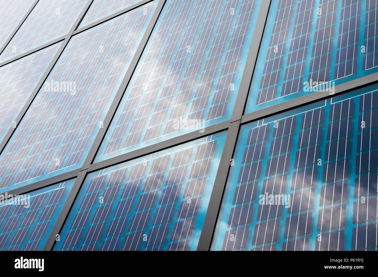 Solar panels blue grid with metal frames in a full-frame background close-up - Stock Image