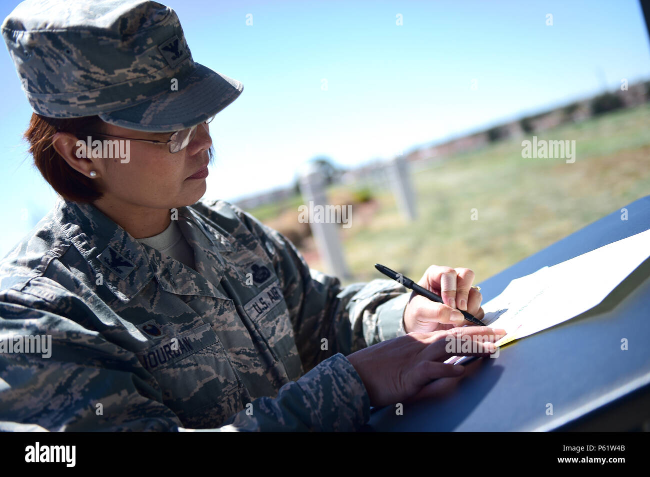 Col. Rose Jourdan, 460th Mission Support Group commander, signs an annual proclamation during an Earth and Arbor Day celebration April 21, 2016, on Buckley Air Force Base, Colo. In 1970, President Richard Nixon proclaimed the last Friday in April as National Arbor Day. (U.S. Air Force photo by Senior Airman Racheal E. Watson/Released) - Stock Image
