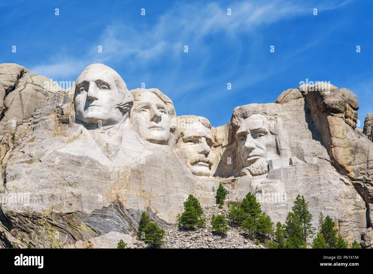 Presidential sculpture at Mount Rushmore national memorial, USA. Sunny day, blue sky. - Stock Image