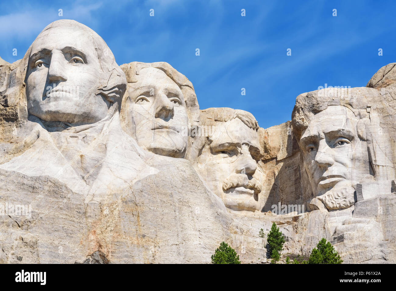 Closeup of presidential sculpture at Mount Rushmore national memorial, USA. Blue sky background. Stock Photo