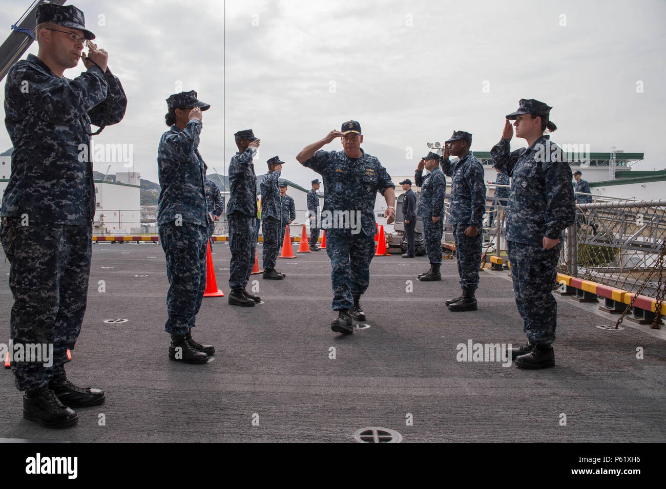 SASEBO, Japan (April 7, 2016) – Commander, Expeditionary Strike Group (ESG) 7, Rear Adm. John B. Nowell Jr. salutes sideboys as he enters the quarterdeck aboard amphibious assault ship USS Bonhomme Richard (LHD 6). Bonhomme Richard is the lead ship of the Bonhomme Richard Amphibious Ready Group and is forward-deployed in the U.S. 7th Fleet area of operation. (U.S. Navy photo by Mass Communication Specialist 3rd Class Jeanette Mullinax/Released) Stock Photo