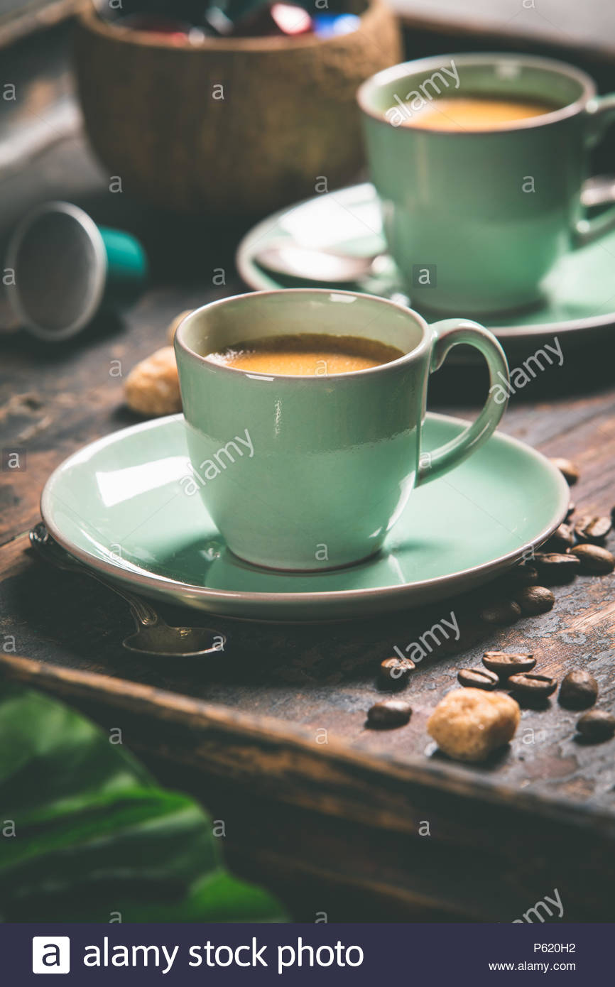 Cups of coffee and capsules - Stock Image
