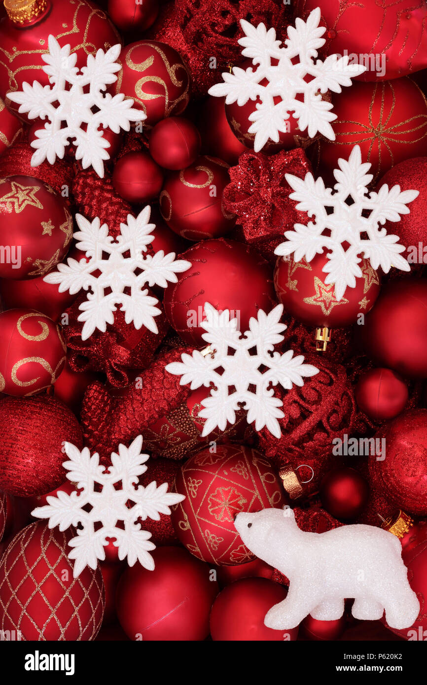 red christmas decorations with white snowflake baubles and polar bear forming an abstract background traditional christmas greeting card for the holi