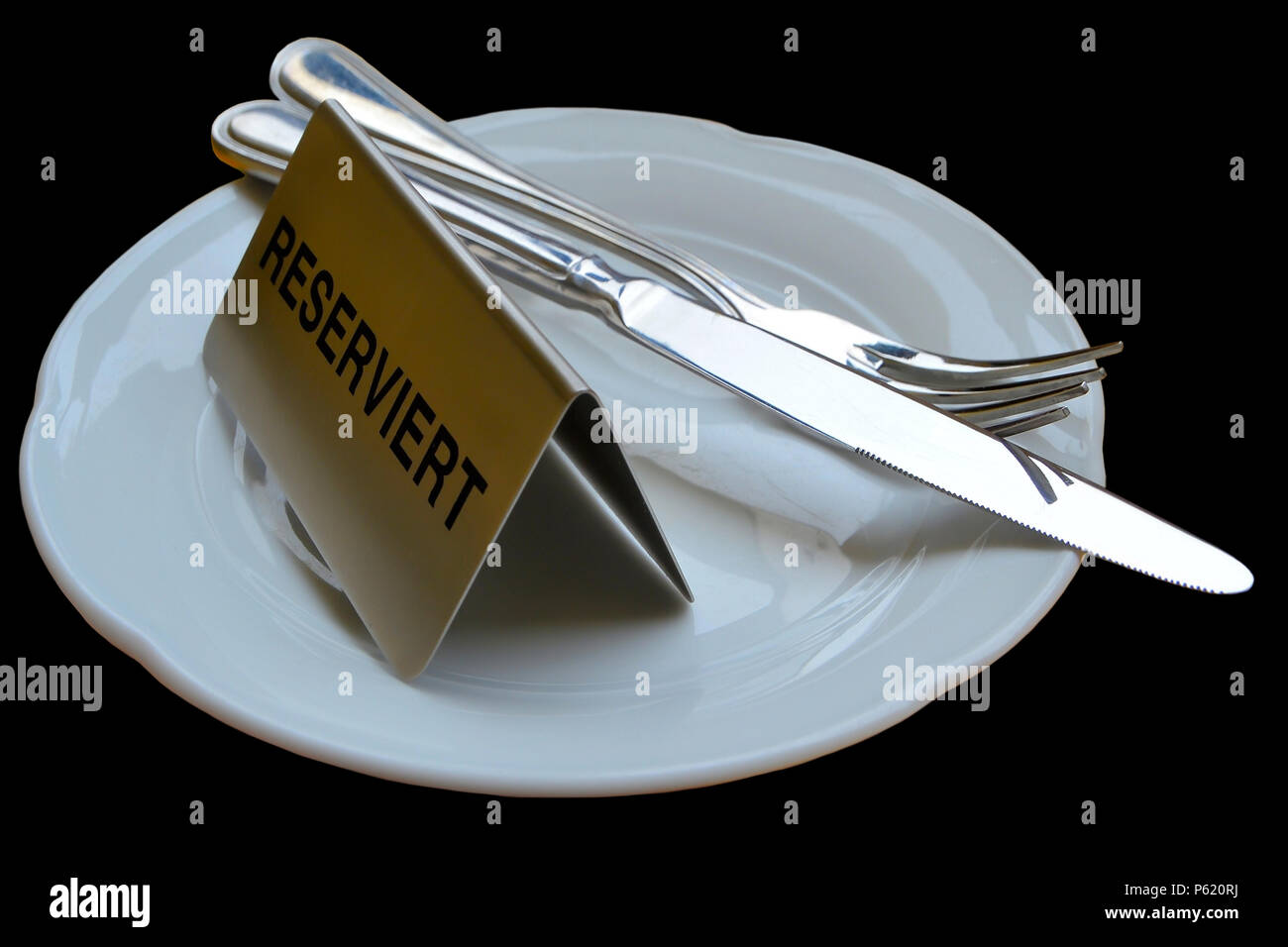 reserved table in a restaurant - Stock Image