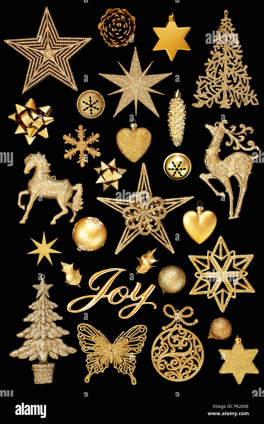 christmas gold joy sign and bauble decorations isolated on black background
