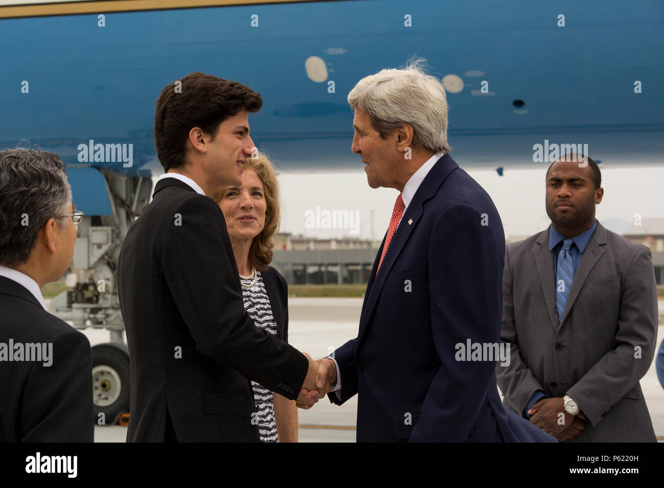 John f kerry the us secretary of state shakes hands with jack john f kerry the us secretary of state shakes hands with jack schlossberg son of caroline bouvier kennedy us ambassador to japan while visiting altavistaventures Gallery
