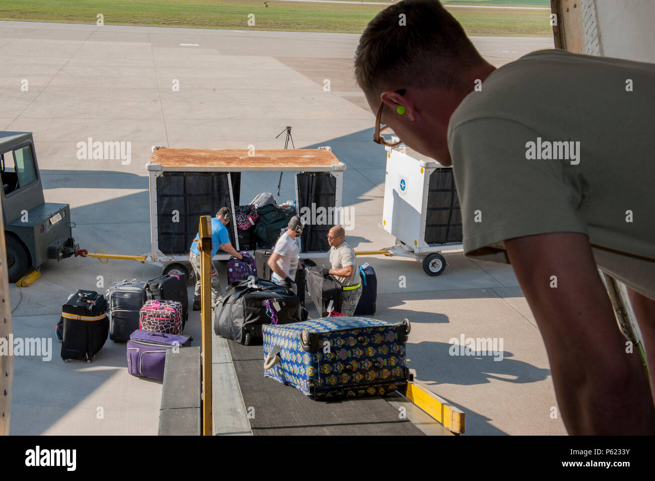 Members of the 728th Air Mobility Squadron load cargo April 1, 2016, at Incirlik Air Base, Turkey. Airmen from the 728th AMS built, staged and transported luggage to load in an aircraft to aid in the process of an ordered departure. (U.S. Air Force photo by Staff Sgt. Jack Sanders/Released) - Stock Image