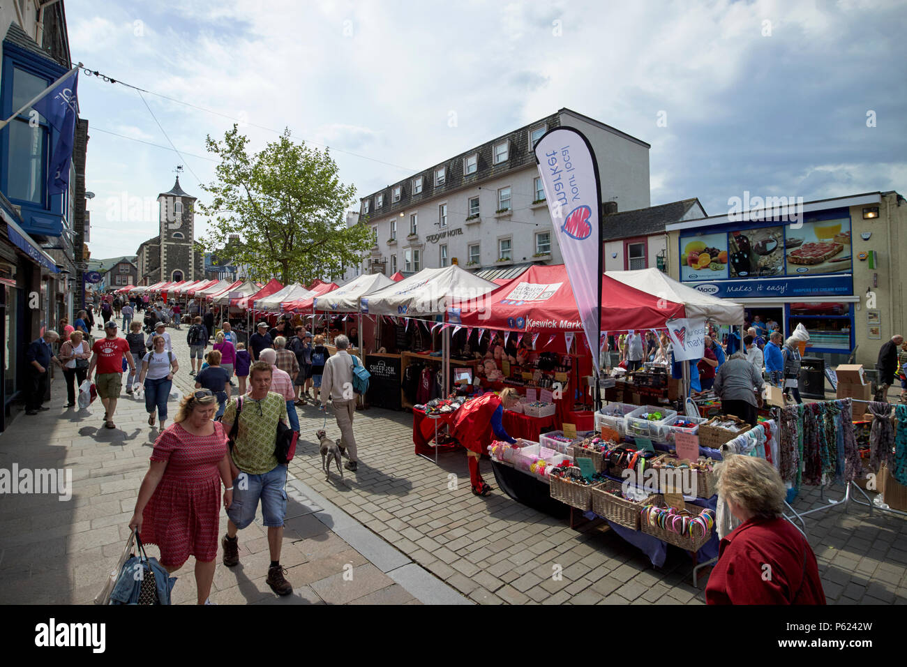 busy Keswick market on main street Lake District Cumbria England UK - Stock Image